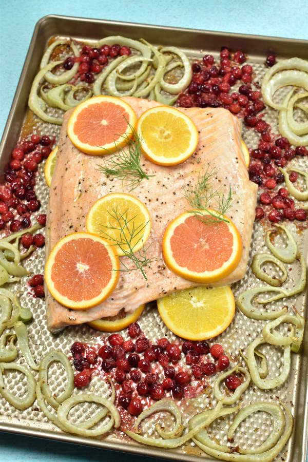 salmon topped with citrus on a sheet pan